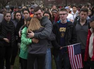 Scott Turner is hugged by friends as he weeps at a vigil for bomb victims a day after two explosions hit the Boston Marathon in Boston